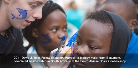 2011 Beck Fellow Elisabeth Maxwell pictured painting a child's face while working as an intern at the South African Shark Conservancy