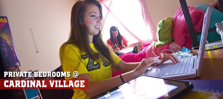 image taken of students at cardinal village