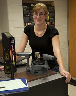 Keeley Townley-Smith standing in physics lab
