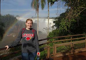 Amy Morgan stands in front of Iguazu Falls in Argentina