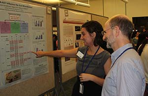 Crissie Vandehoef discusses her research poster with her mentor at the NIH