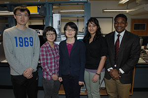 students with assistant professor Suying Wei in chemistry lab