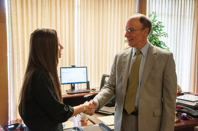 Dr. Evans shaking hands with Madison