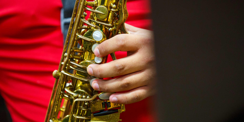 Student holding brass instrument