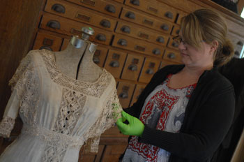 Conservator inspects museum clothing