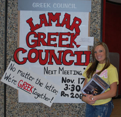 Candice Montgomery with Greek Council bulletin board
