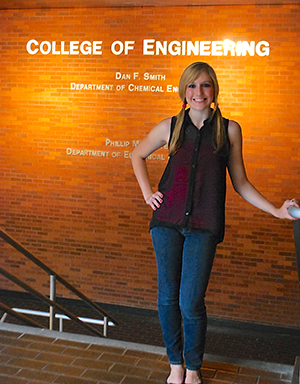 Tyler Doiron stands in engineering building