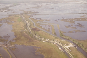 image of Isle De Jean Charles - aerial shot of section of flooded land with road and houses