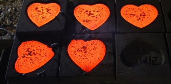 Heart molds cooling after iron pour