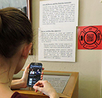 Patron using QR code at Fire Museum